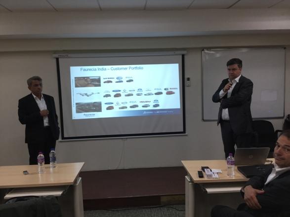 Eric Borgard-Group IT-Engineering Director-Faurecia & Vidyadhar Limaya-India Director-Faurecia making presentation at Dassault's automotive roundtable
